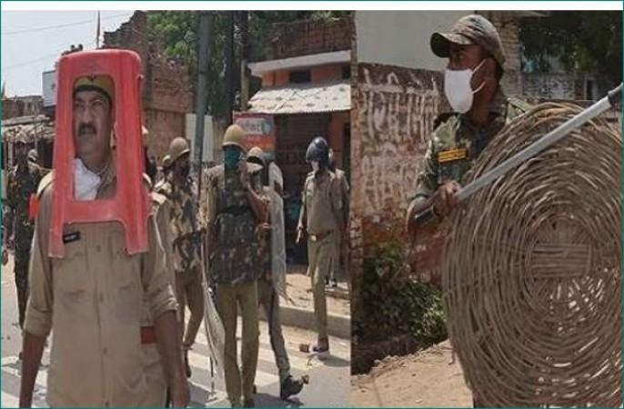 उन्नाव: सस्पेंड हुए सिर पर प्लास्टिक स्टूल लेकर खुद की सुरक्षा कर रहे सिपाही और इंस्पेक्टर