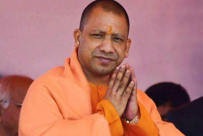 UP CM Yogi Adityanath distributes laptops to revenue accountants