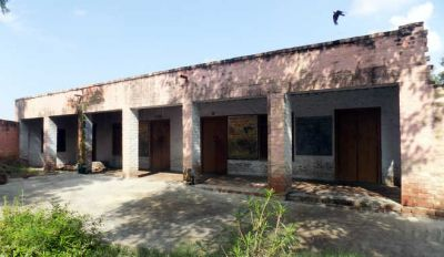 Students studying in shabby building of primary school, future in darkness