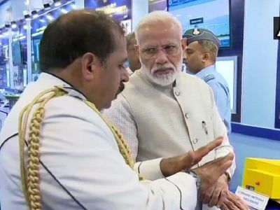 PM Modi visits an exhibition at the residence of Air Chief Marshal