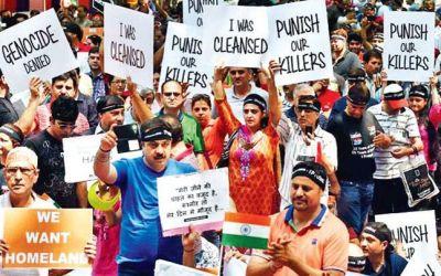 Kashmiri Pandits pledge to return home, pay tribute to martyrs