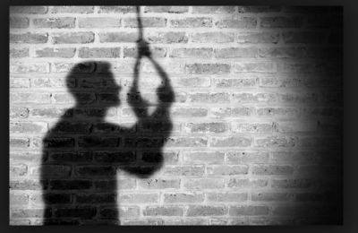 Scored low in the examination, committed suicide