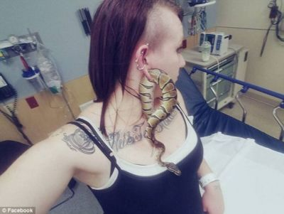 Pet Python gets stuck in the ear of this woman