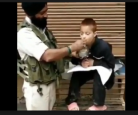 A Twitter Video Went Viral when CRPF personnel feed a physically disabled child with his hand