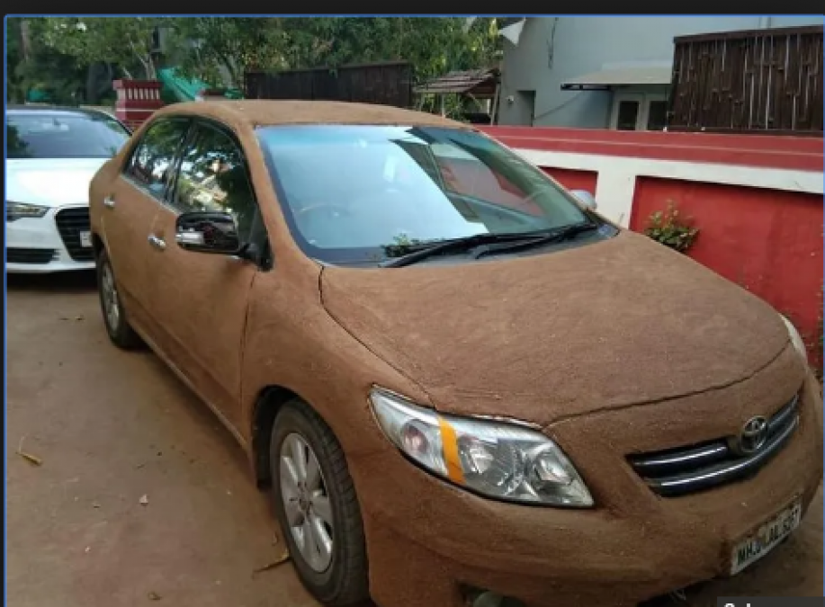 A Man paint Cow Dung all over his White Car; know here why he does like that