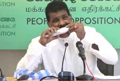 Minister eats raw fish in press conference to promote sales hit, Watch video