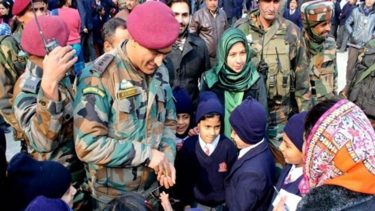 MS Dhoni plays cricket with children in military uniform