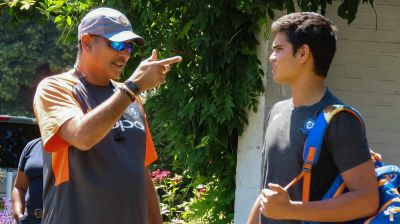 Arjun Tendulkar practices with the Indian team get a tip from Shastri