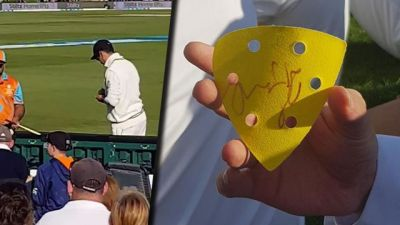 Ross Taylor signs on a sandpaper for fans