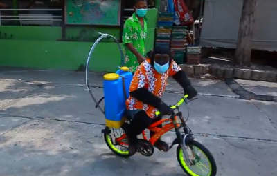 Chimpanzee wears mask and rides a bike to spray sanitizer in Thailand Zoo
