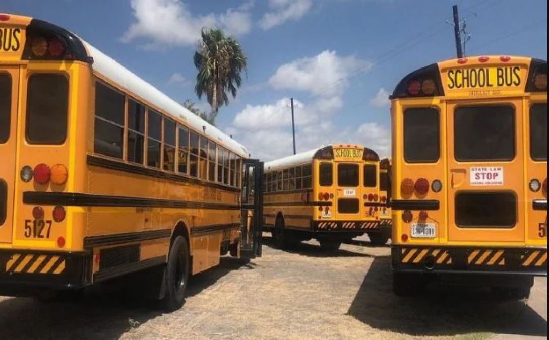 When was school bus first used, why they are yellow in color?