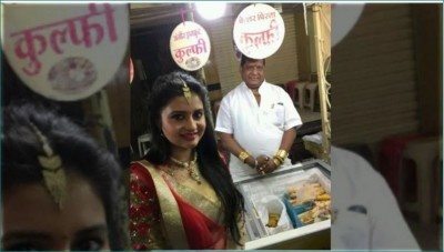 This shopkeeper sells kulfi wearing more than half a kilo of gold