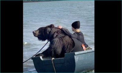 This girl has kept a sail bear, both of them were seen fishing on a boat