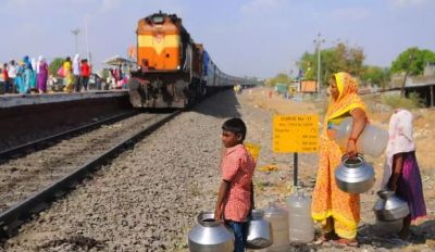 A 10-year-old boy do life threating train travel every day for water