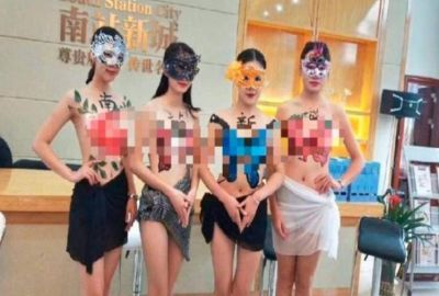 For the Company's promotion, the women fell their respects such level that took off clothes and then
