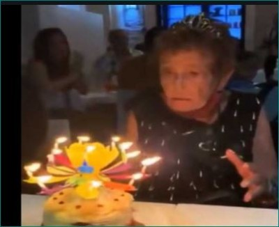 Elderly woman's reaction at blooming musical flower candle, Video viral