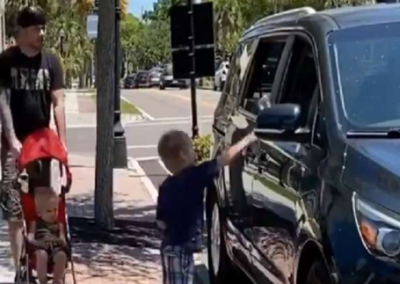 Child teaches a lesson to car driver for throwing bottle on road