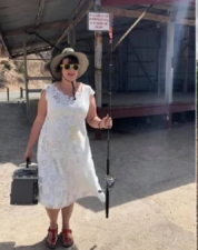 This woman loves her wedding dress very much, seen everywhere in this dress
