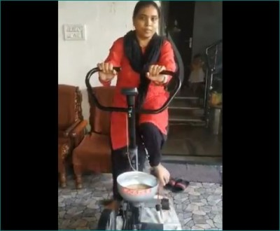 Woman exercising and grinding wheat simultaneously, video going viral