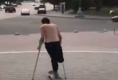 Disabled person performs stunts with skateboard