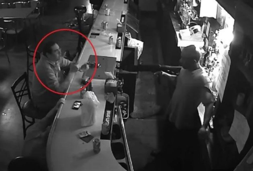 Unfazed Guy Sits And Smokes At Bar As Armed Robbery Takes Place