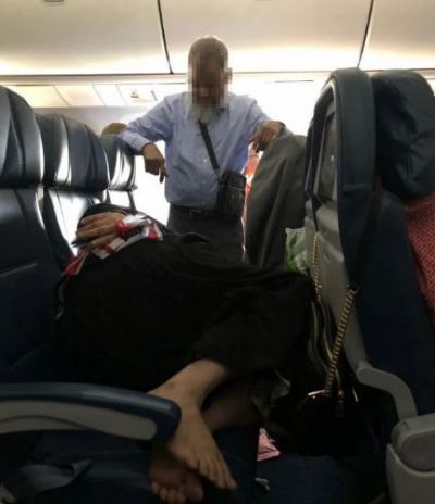 Photos: Man stands for 6 hours on flight to let wife sleep