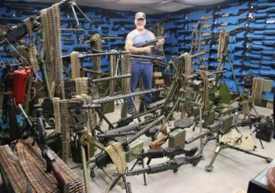 This man is crazy about guns, has guns everywhere from the bedroom to bike