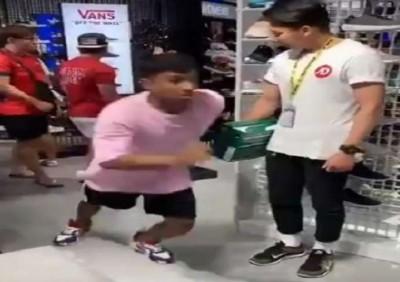 Boy runs away wearing new shoes from shoe-shop, salesman shocked