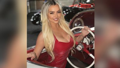 This model flaunts her white sexy body in red color dress