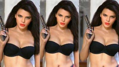 Sherlin Chopra wearing a black bra grabbed the shotgun, saying,