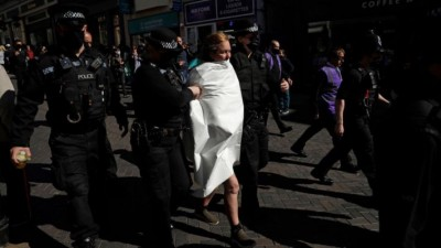 Topless woman arrested during Prince Philip's funeral