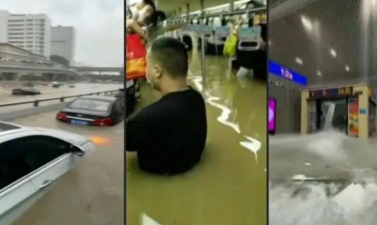 सड़कें जलमग्न, लोगों के गले-गले तक पहुंचा पानी.... चीन में बाढ़ से भीषण तबाही