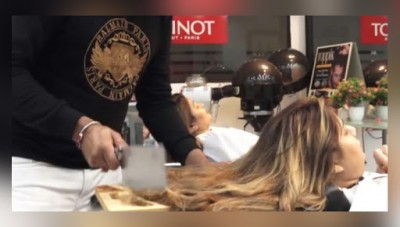 This Barber cuts hair with chopper instead of scissor